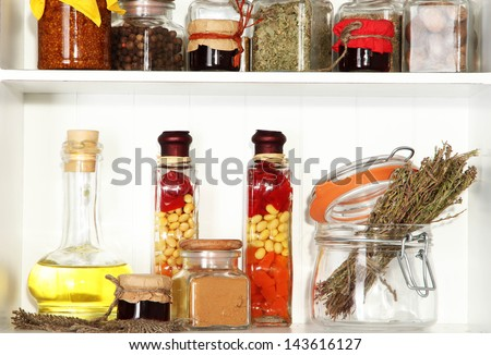 Variety spices on kitchen shelves close-up - stock photo