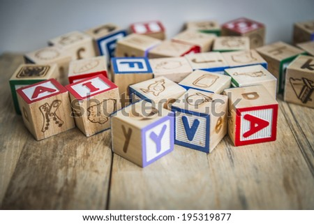Variety wooden blocks on wooden floor - stock photo
