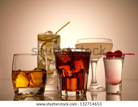 Various alcoholic cocktails and shots - stock photo