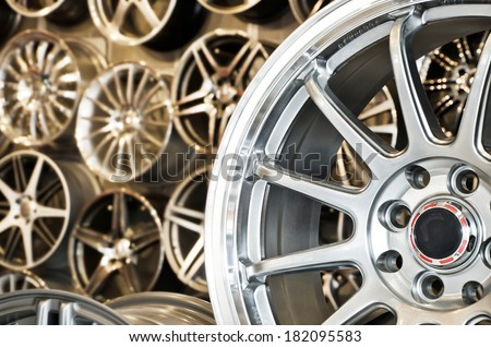Various alloy wheels in store, selective focus. - stock photo