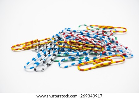 Various and colourful paperclips - stock photo