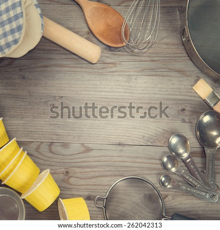Various baking tools arrange from overhead view on wooden table in vintage tone. Copy space on middle with square composition. - stock photo