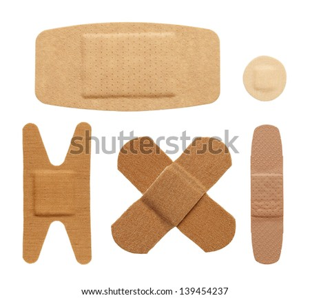 Various bandage shapes sizes and colors isolated on a white background. - stock photo