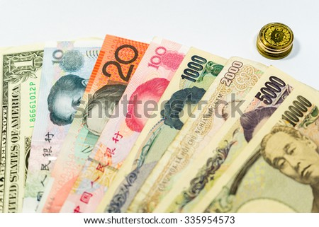 Various banknotes from 10000 to 1, with coins - stock photo
