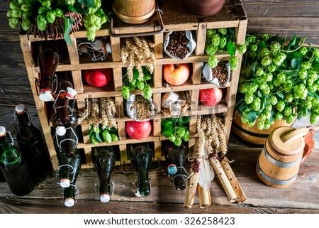 Various beer ingredients in wooden box - stock photo