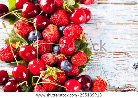 various berries on wooden table - stock photo