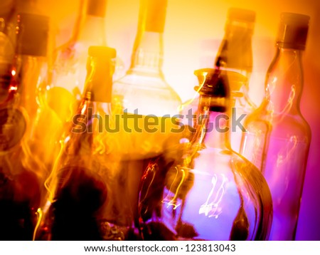 Various bottles at a bar arranged in rows, motion blur - stock photo