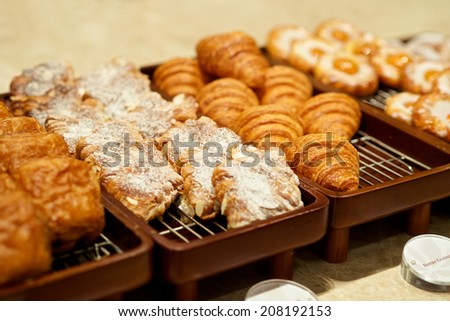 Various buffet sweet bakeries in a hotel restaurant - stock photo