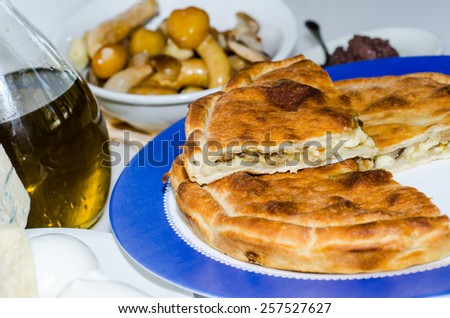 various cheese truffle tiella and mushrooms - stock photo