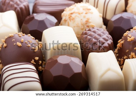 Various chocolate pralines as a background - stock photo