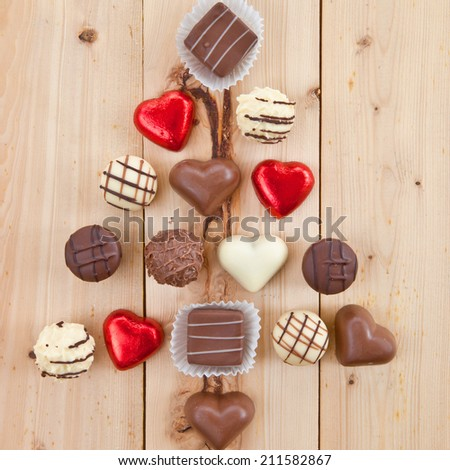 Various chocolates arranged in a christmas tree shape - stock photo