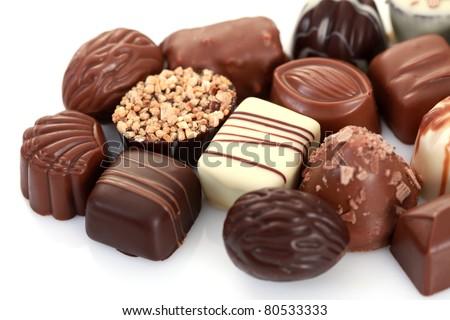 various chocolates on white background - sweet food - stock photo