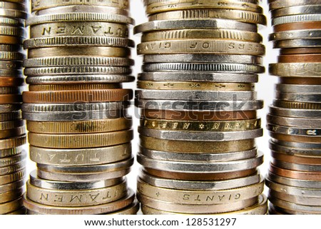 Various coins arranged in stacks shown up close - stock photo