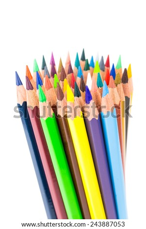 Various colored crayons standing upright isolated on white background - stock photo