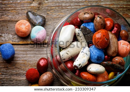 Various Colored Gum and Hard Candies in Glass Jar on Rustic Wooden background. Top View - stock photo
