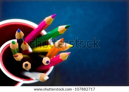 Various Colored Pencils isolated on blue background. Macro with extremely shallow depth of field - stock photo