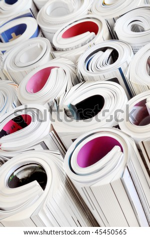 Various colored rolled magazines - stock photo