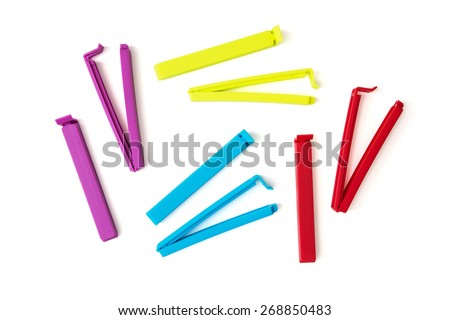 Various colorful bag clips isolated on the white background. Funny photo. - stock photo