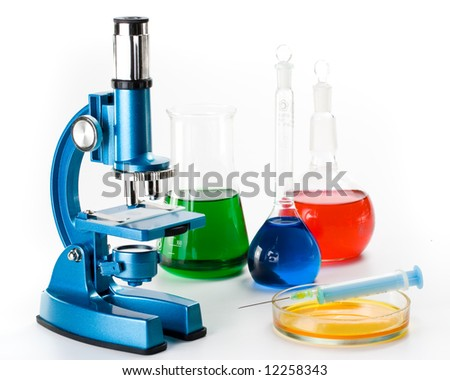 Various colorful flasks and blue microscope over white background - stock photo
