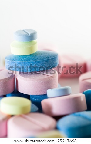 Various colorful pills on a white background. - stock photo