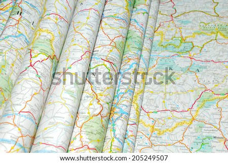 Various colorful road maps folded - stock photo
