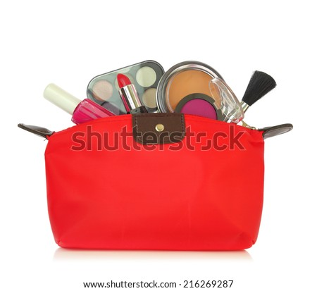 Various cosmetics in a red bag isolated on white - stock photo