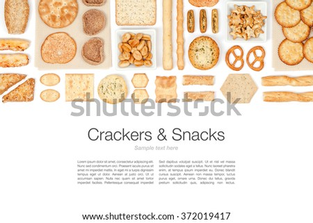 various crackers and snacks on white background with copy space top view - stock photo