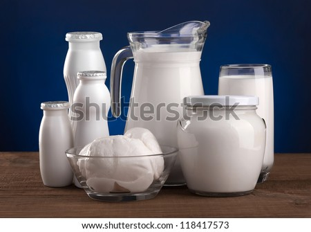 Various dairy products: cheese, sour cream, milk, yogurt, kefir. On a blue background. - stock photo