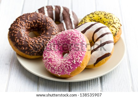 various donuts on kitchen table - stock photo