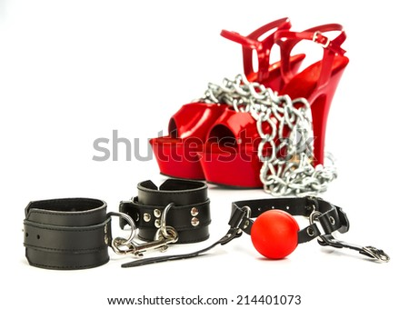 Various fetish stuff for role playing and BDSM: hand cuffs, a ball gag and high heels shoes - stock photo