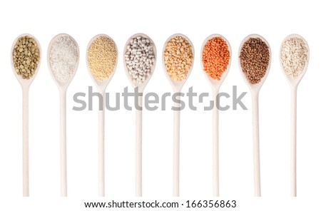 various food ingredients in wooden spoon isolated on white background - stock photo