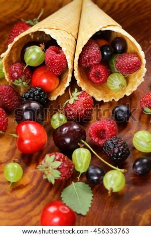 various fresh organic berries in waffle cone ice cream - stock photo