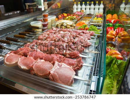 Various fresh raw meat prepared for barbecue in a store - stock photo