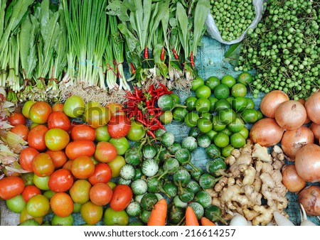 Various fresh vegetables in Asian traditional street market. Healthy food background  - stock photo