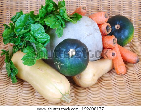 Various freshly harvested healthy organic vegetables in a basket. - stock photo
