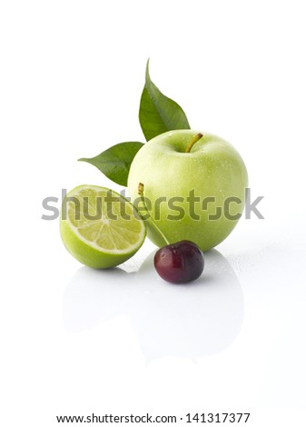 Various fruits (Green apple, lime, cherry) with leaf, isolated on the white background with soft shadow - stock photo
