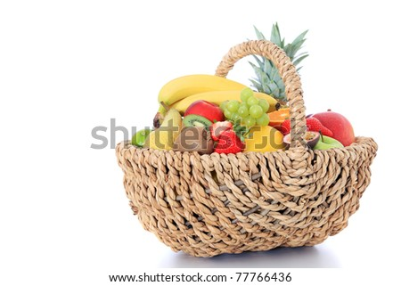 Various fruits in a basket. All on white background. - stock photo