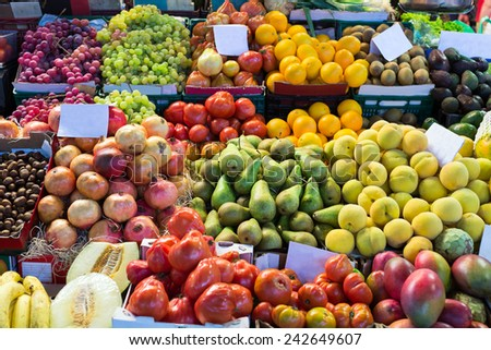 Various fruits on spanish market counter - stock photo