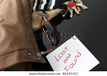 Various items on a lost and found table. - stock photo