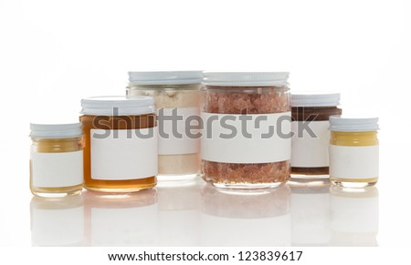 Various Jars of Handmade Bath Products, Salts, Scrubs, Butters and Solutions - stock photo