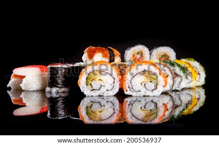 Various kind of sushi food served on black background - stock photo