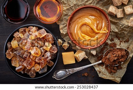 Various kinds of caramelized sugar, top view - stock photo