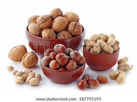 various kinds of nuts on a white background - stock photo