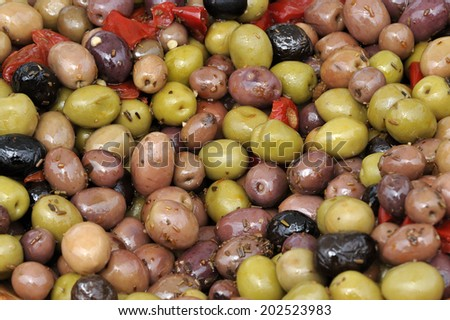 Various kinds of olives at a farmers market  - stock photo