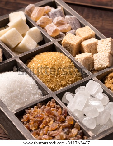 Various kinds of sugar in box closeup - stock photo