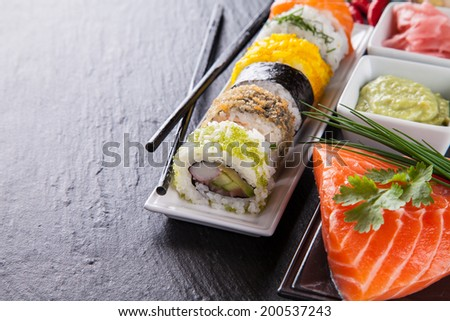 Various kinds of sushi food served on black stone - stock photo