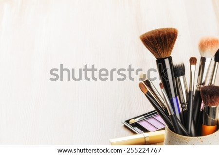 Various makeup brushes on light background with copyspace  - stock photo