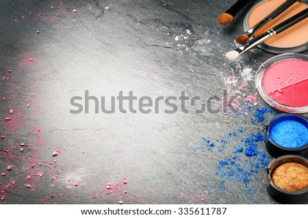 Various makeup products and professional brushes. Copy space - stock photo