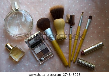 Various makeup products . Perfume, brush and cosmetic on a pink background. Top view. - stock photo