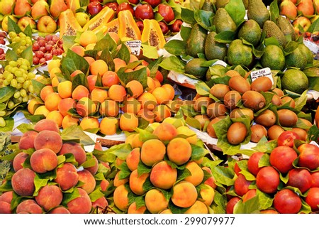 Various many different fresh fruits at a farmers market - stock photo